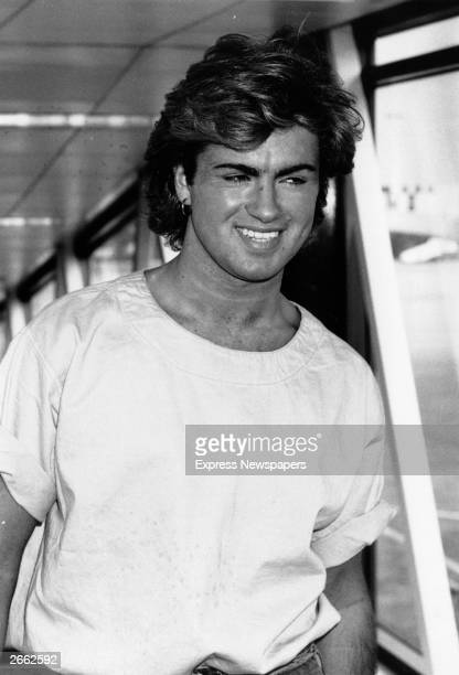 British singer songwriter George Michael lead singer of the pop group Wham arriving at an airport Original Publication People Disc HU0449