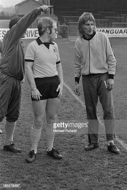 British singers Elton John and Rod Stewart training at Watford Football Club's Vicarage Road ground in Watford Hertfordshire November 1973