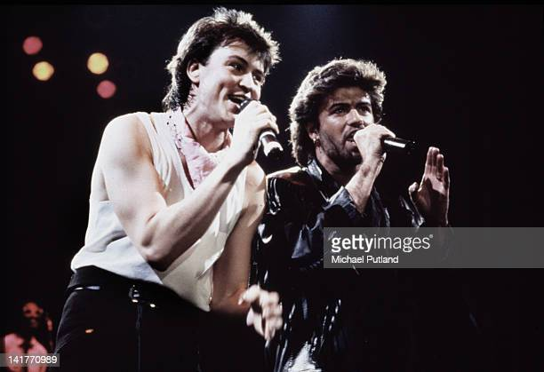 British singers Paul Young and George Michael perform on stage UK circa 1985