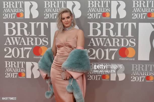 CORRECTION British singersongerwriter AnneMarie Nicholson poses on the red carpet arriving for the BRIT Awards 2017 in London on February 22 2017 /...