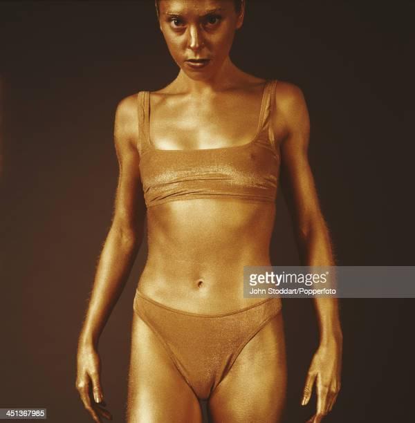 British singersongwriter and actress Melanie C posing wearing gold body paint circa 1996