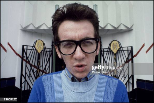 British singersongwriter Elvis Costello photographed outside The Hoover Building on Western Avenue in Perivale London 1978 Costello wrote a tribute...