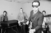 British singersongwriter Elvis Costello with his backing band The Attractions UK 1980 From left to right keyboard player Steve Nieve bassist Bruce...