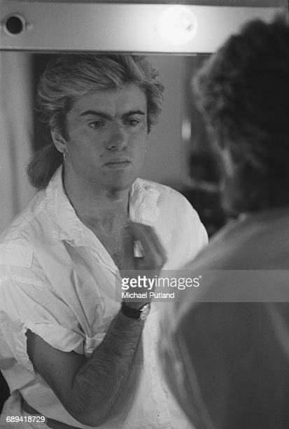 British singersongwriter George Michael of Whamapplying make upduring the pop duo's 1985 world tour January 1985'The Big Tour' took in the UK Japan...