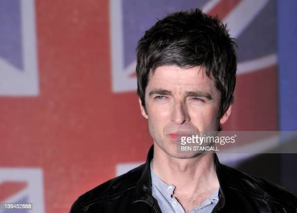 British singersongwriter Noel Gallagher poses on the red carpet arriving at the BRIT Awards 2012 in London on February 21 2012 AFP PHOTO / BEN...