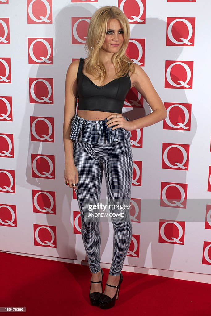 British singer-songwriter Pixie Lott attends The Q Awards 2013 in central London on October 21, 2013. AFP PHOTO/ANDREW COWIE