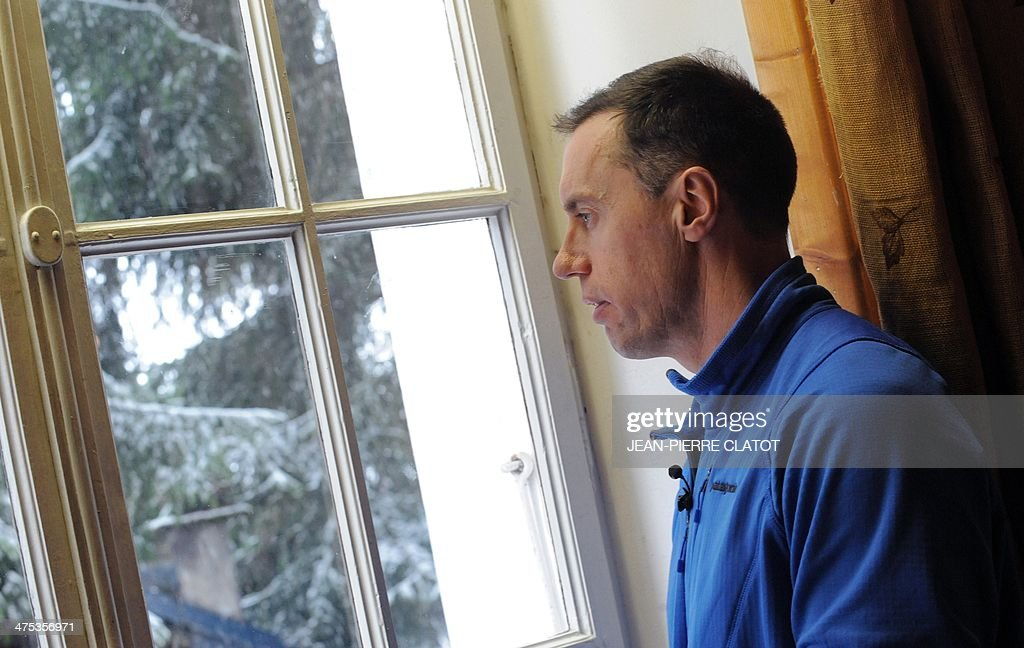British ski instructor Simon Butler looks by the window of his office in Megeve on February 26, 2014. Simon Butler will be on trial in April for delivering ski lessons without having the French required diploma.