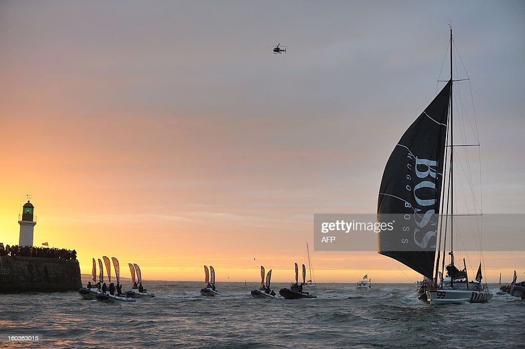 British skipper Alex Thomson arrives on his monohull 'Hugo Boss' placing third in the 7th edition of the Vendee Globe solo round-the-world race on January 30, 2013 in Les Sables d'Olonne, western France. AFP PHOTO JEAN-SEBASTIEN EVRARD