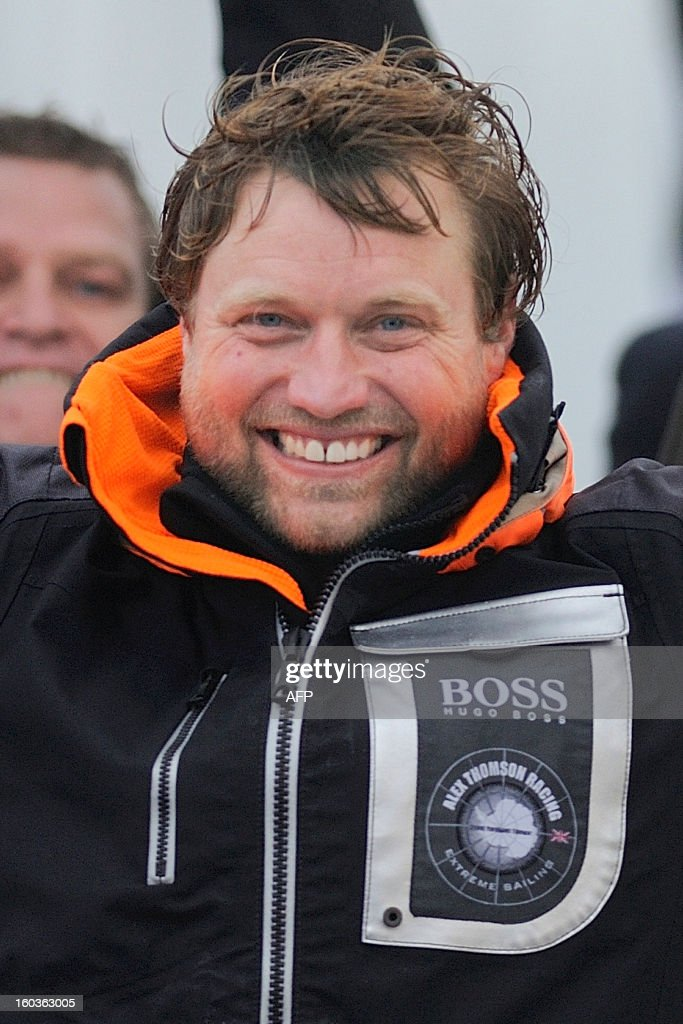 British skipper Alex Thomson celebrates on his monohull 'Hugo Boss' after placing third in the 7th edition of the Vendee Globe solo round-the-world race on January 30, 2013 in Les Sables d'Olonne, western France. AFP PHOTO JEAN-SEBASTIEN EVRARD