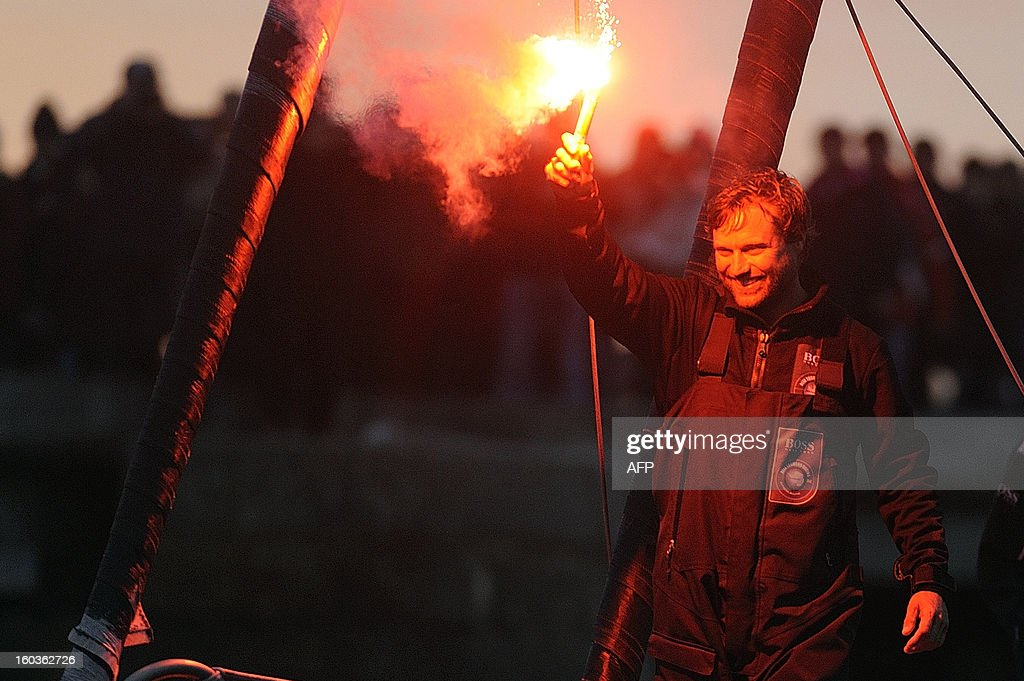 British skipper Alex Thomson celebrates on 'Hugo Boss' after placing third in the 7th edition of the Vendee Globe solo round-the-world race on January 30, 2013 in Les Sables d'Olonne, western France. AFP PHOTO JEAN-SEBASTIEN EVRARD