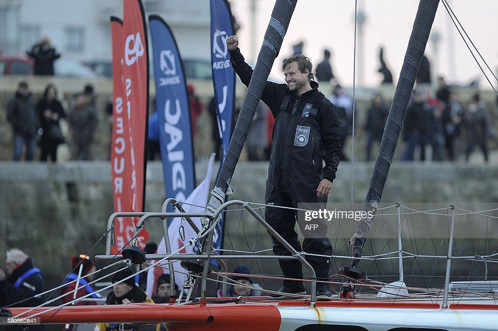 British skipper Alex Thomson celebrates on 'Hugo Boss' after placing third in the 7th edition of the Vendee Globe solo round-the-world race on January 30, 2013 in Les Sables d'Olonne, western France.