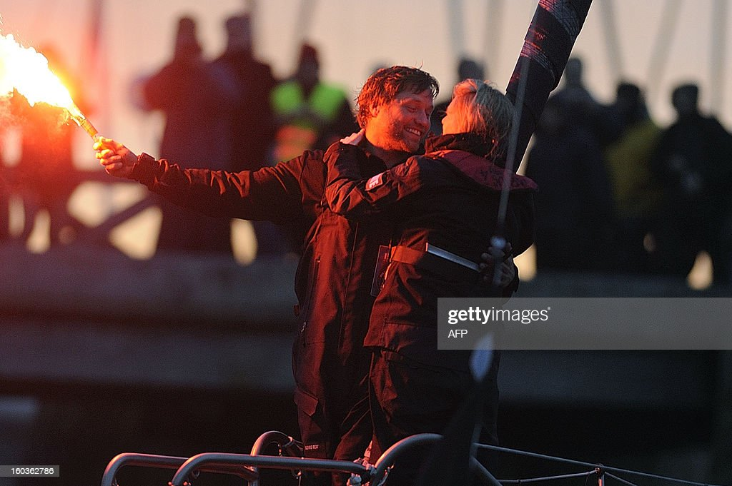 British skipper Alex Thomson celebrates with his wife Kate (R) on 'Hugo Boss' after placing third in the 7th edition of the Vendee Globe solo round-the-world race on January 30, 2013 in Les Sables d'Olonne, western France. AFP PHOTO JEAN-SEBASTIEN EVRARD