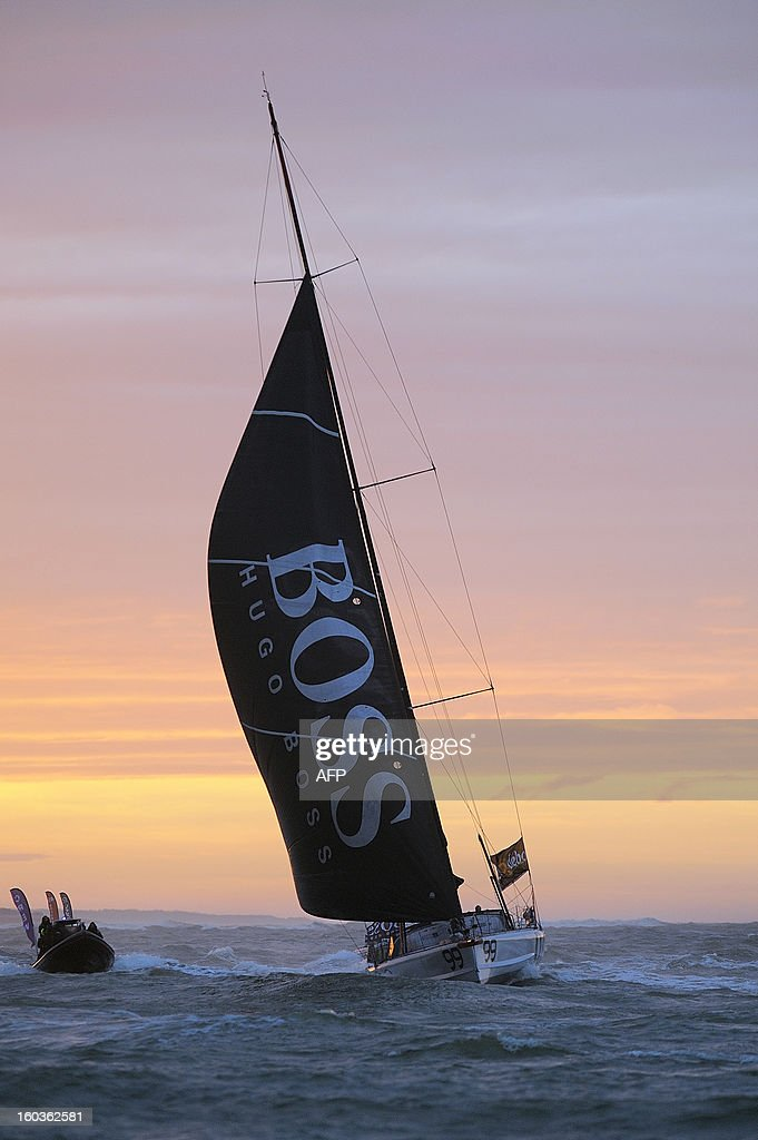 British skipper Alex Thomson crosses the finish line in his monohull 'Hugo Boss' after placing third in the 7th edition of the Vendee Globe solo round-the-world race on January 30, 2013 in Les Sables d'Olonne, western France. AFP PHOTO JEAN-SEBASTIEN EVRARD