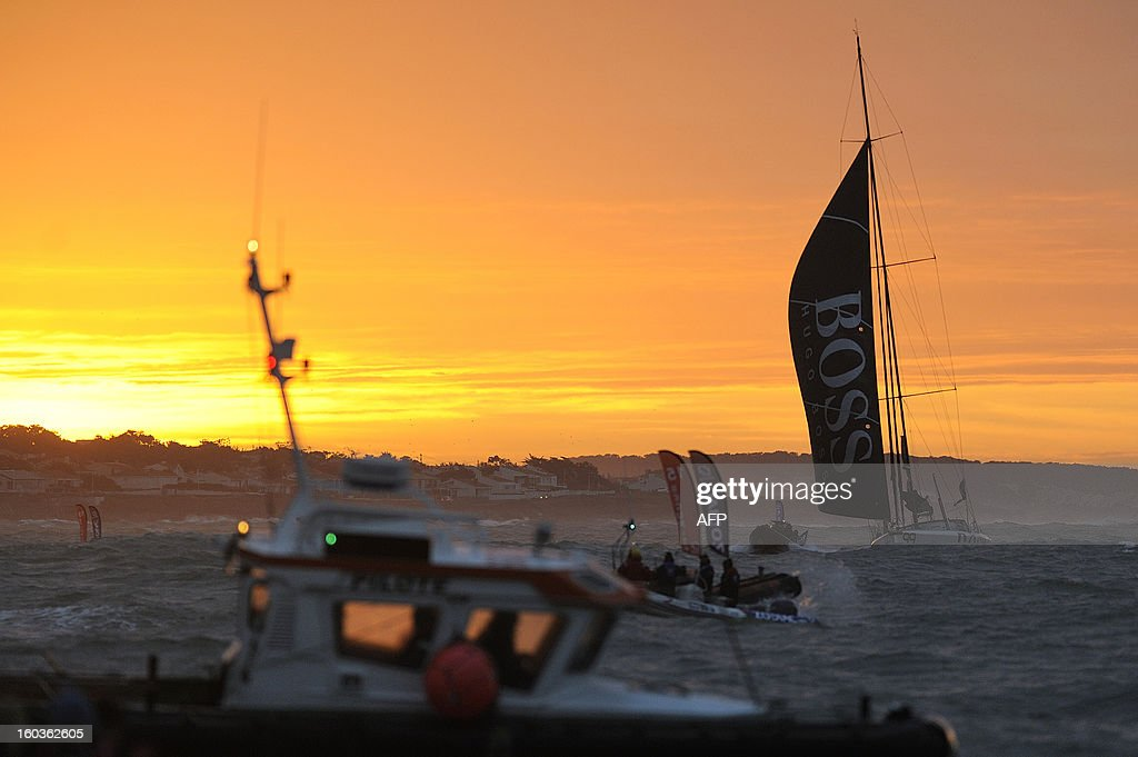British skipper Alex Thomson crosses the finish line in his monohull 'Hugo Boss' after placing third in the 7th edition of the Vendee Globe solo round-the-world race on January 30, 2013 in Les Sables d'Olonne, western France.