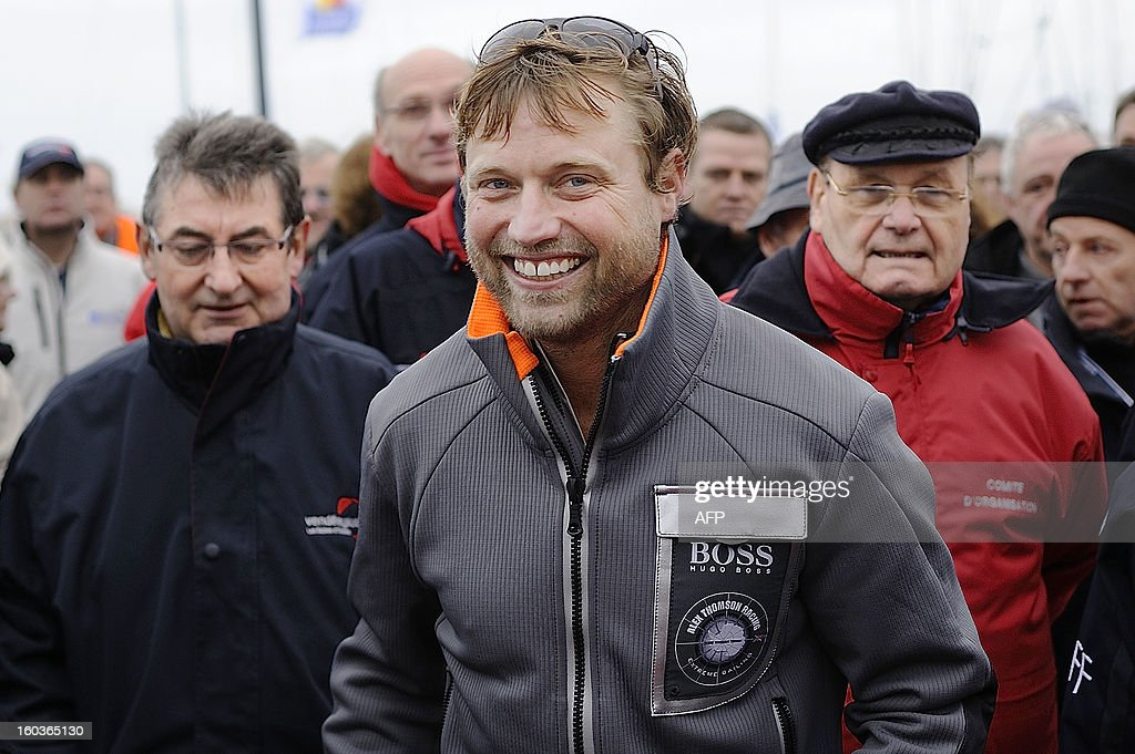 British skipper Alex Thomson smiles after placing third in the 7th edition of the Vendee Globe solo round-the-world race on January 30, 2013 in Les Sables d'Olonne, western France. AFP PHOTO JEAN-SEBASTIEN EVRARD