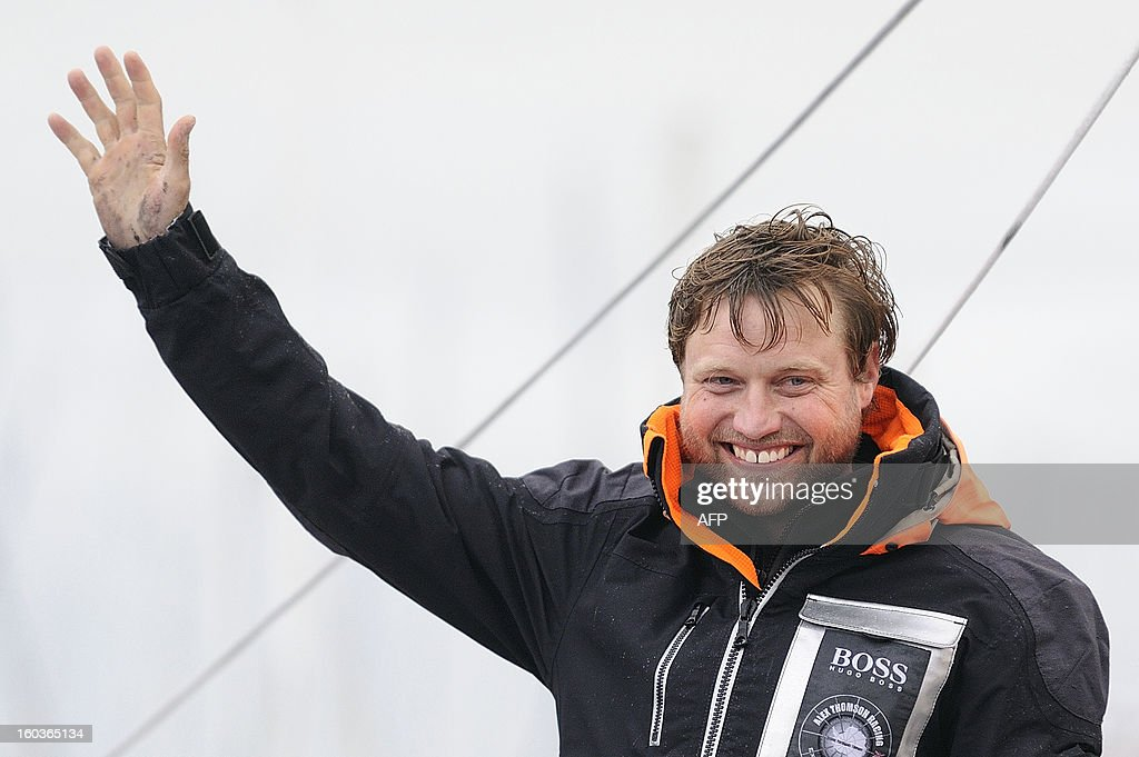 British skipper Alex Thomson waves on his monohull 'Hugo Boss' after placing third in the 7th edition of the Vendee Globe solo round-the-world race on January 30, 2013 in Les Sables d'Olonne, western France.