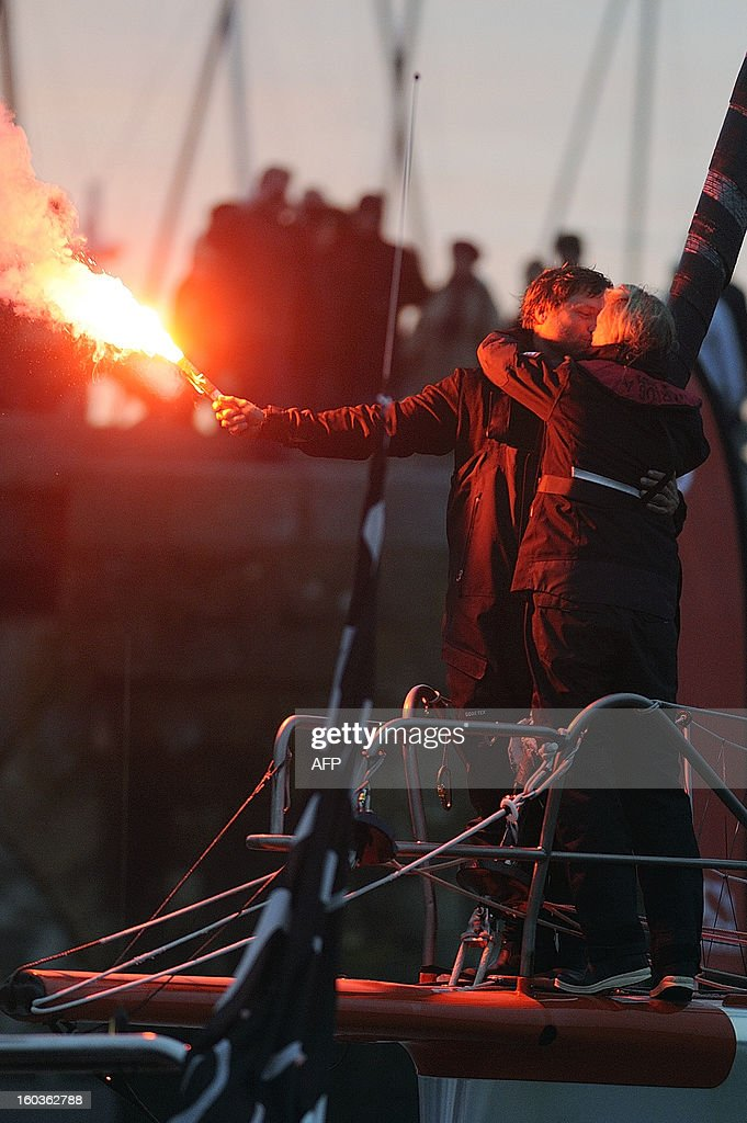 British skipper Alex Thomson with his wife Kate (R) celebrates on 'Hugo Boss' after placing third in the 7th edition of the Vendee Globe solo round-the-world race on January 30, 2013 in Les Sables d'Olonne, western France. AFP PHOTO JEAN-SEBASTIEN EVRARD