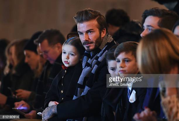 British soccer player David Beckham and his children attend his wife Victoria Beckham's show during the Fall 2016 New York Fashion Week on February...