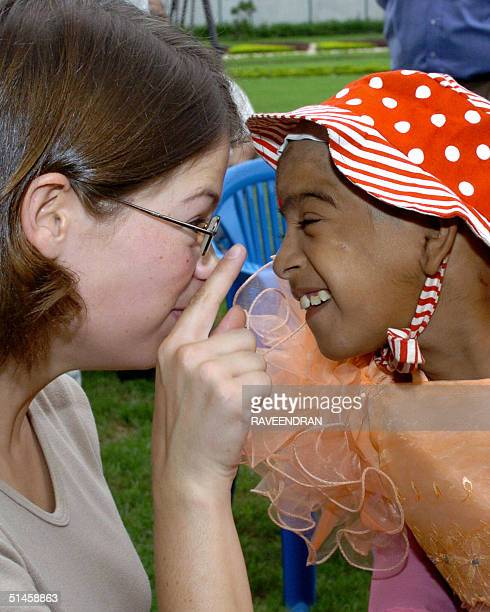 British social worker Charlotte Dolenz meets with mentally challenged Indian child Ritu on the occasion of World Mental Health Day at India's Chief...