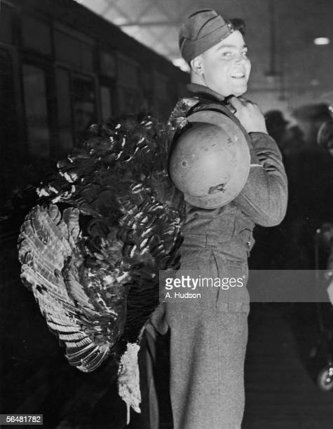 A British soldier arrives at Euston Station with a large turkey before heading north on leave during World War II 22nd December 1939