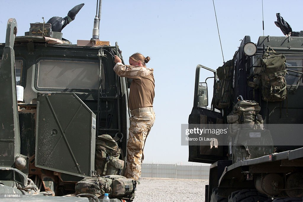 British soldier from the 13 Air Assault Support Regiment goes through the last checks on her vehicle before leaving on an operation to deliver...