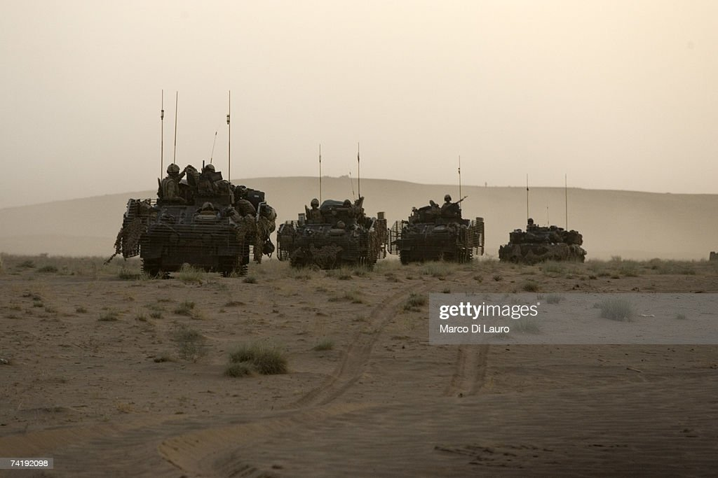 British Soldier from the B Squadron of The Light Dragoons Regiment ride their Spartan tank in a location in the desert to conduct counter Taleban...