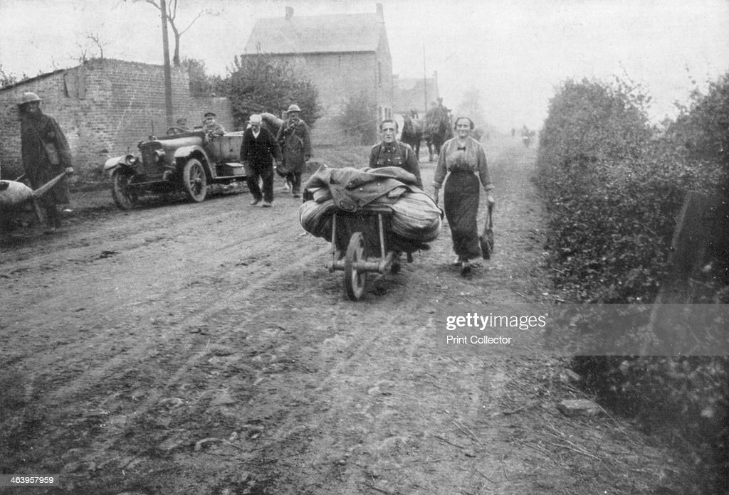 A British soldier helping a woman return to her village between Le Cateau and Cambrai France 1918 The Allied advance of the summer and autumn of 1918...