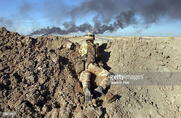 British soldier keeps watch from a checkpoint April 2 2003 in Um Quasr as fighting continues just outside the Iraqi city of Basra