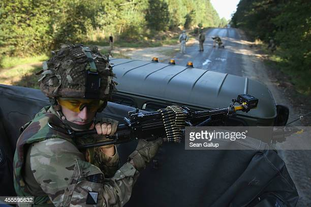 British soldier of the Light Dragoons helps guard a convoy on the third day of the 'Rapid Trident' bilateral military exercises between the United...