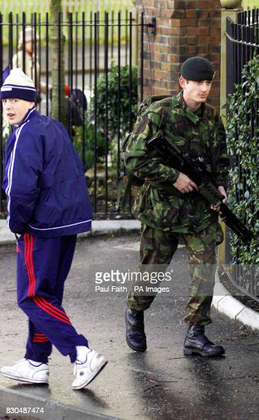 A British soldier patrols the streets of North Belfast Northern Ireland Troops have stepped up their patrols following the upsurge in loyalist...