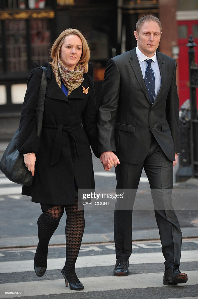 British soldier Sergeant Danny Nightingale (R) and his wife Sally, arrive at the High Court in central London, on March 13, 2013, as he prepares to appeal against his convictions for illegally possessing a Glock 9mm pistol and ammunition.