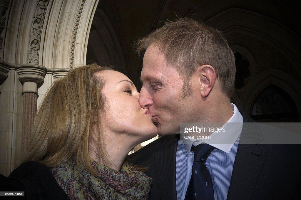 British soldier Sergeant Danny Nightingale (R) and his wife Sally, kiss as they arrive at the High Court in central London, on March 13, 2013, as he prepares to appeal against his convictions for illegally possessing a Glock 9mm pistol and ammunition. Nightingale won his appeal against a conviction for illegally possessing a pistol and ammunition.