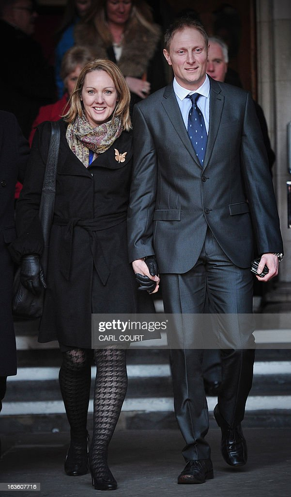 British soldier Sergeant Danny Nightingale (R) and his wife Sally, leave the High Court in central London, on March 13, 2013, after he won an appeal against a conviction for illegally possessing a a Glock 9mm pistol and ammunition.
