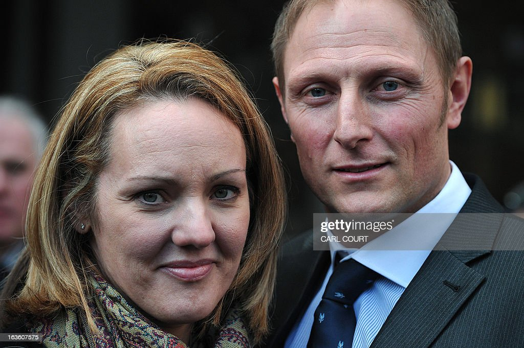 British soldier Sergeant Danny Nightingale (R) and his wife Sally, pose for photographers as they leave the High Court in central London, on March 13, 2013, after he won an appeal against a conviction for illegally possessing a a Glock 9mm pistol and ammunition.