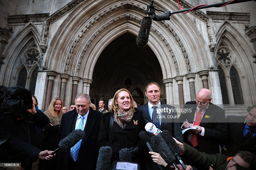 British soldier Sergeant Danny Nightingale (R) and his wife Sally, speak to the media as they leave the High Court in central London, on March 13, 2013, after he won an appeal against a conviction for illegally possessing a a Glock 9mm pistol and ammunition.