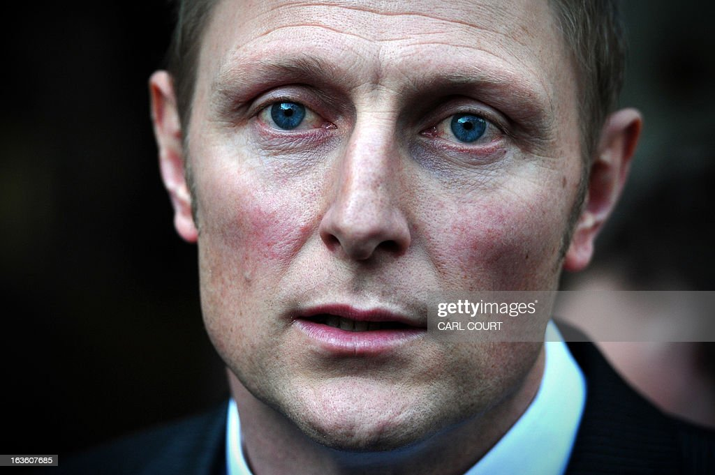 British soldier Sergeant Danny Nightingale speaks to the media as he leaves the High Court in central London, on March 13, 2013, after he won an appeal against a conviction for illegally possessing a a Glock 9mm pistol and ammunition. AFP PHOTO/CARL COURT