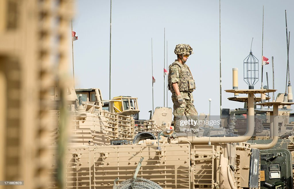 British soldier stands on top of an armoured vehicle as British Prime Minister David Cameron visits Camp Bastion on June 29 2013 near Lashkar Gah in...