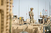 A British soldier stands on top of an armoured vehicle in Camp Bastion in the southern Helmand province on June 29 2013 British Prime Minister David...