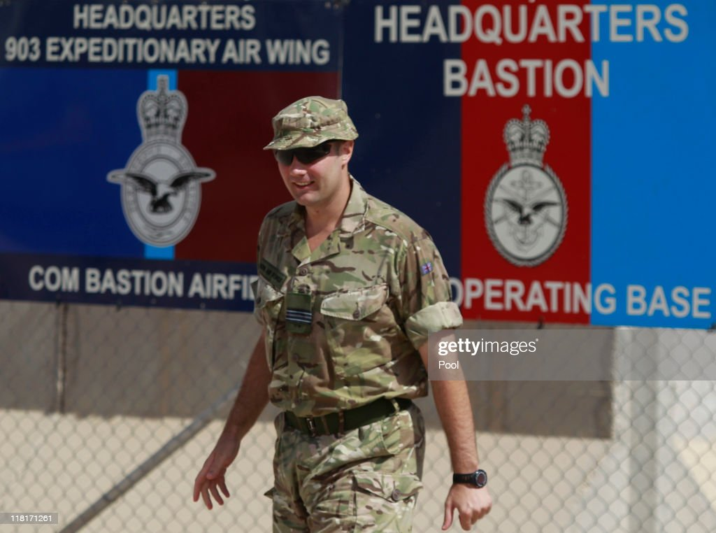 British soldier waits for British Prime Minister David Cameron during a visit at the Afghan National Army training camp at Camp Bastion on July 4...