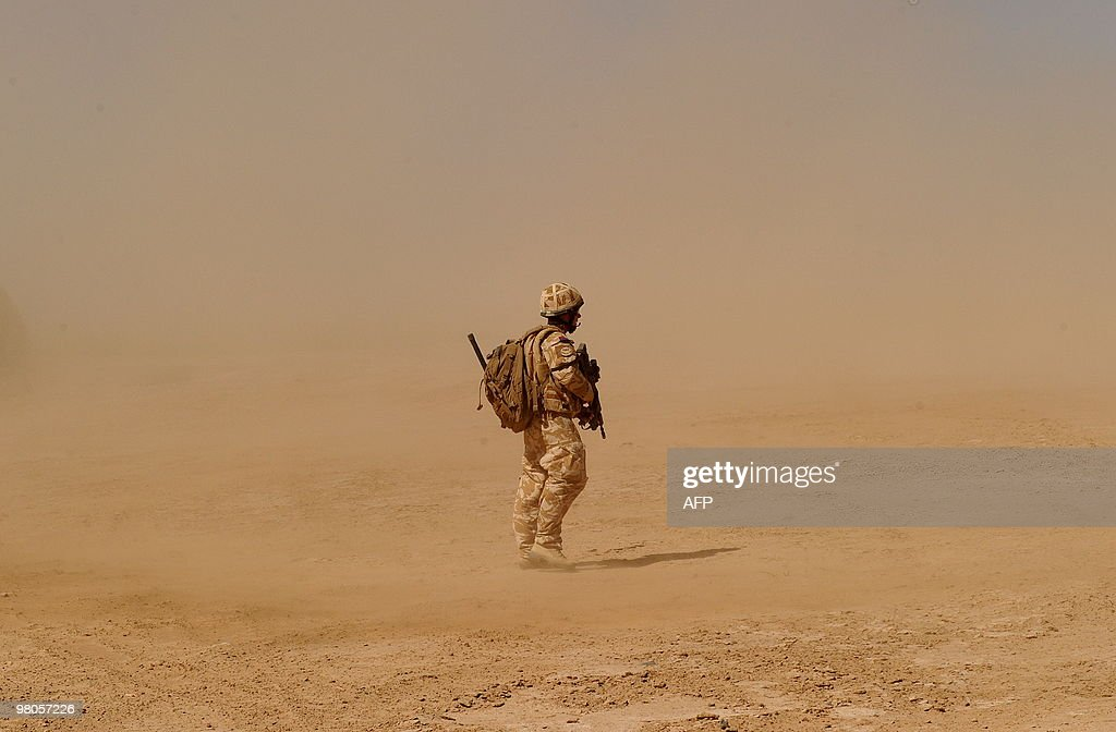 A British soldier walks near the Pimon military camp in Nade Ali district of Helmand province on March 25 2010 Britain's Prince Charles paid tribute...