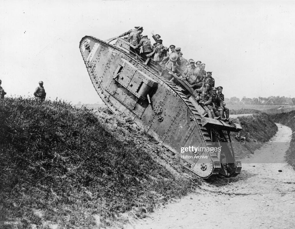 British soldiers enjoy a jaunt on a British Mark IV tank