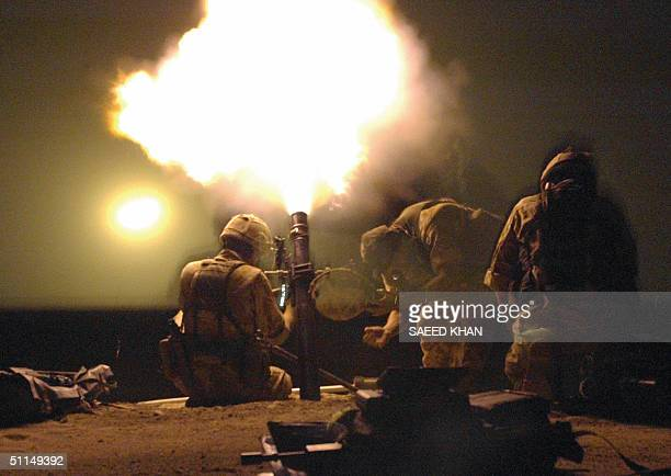British soldiers fire mortars to illuminate the oil pipeline area for surveillance during a patrol on the southern outskirts of Basra early 07 August...