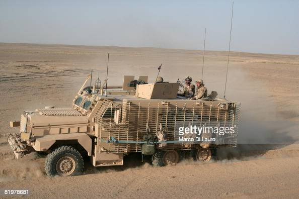 British soldiers from the 13 Air Assault Support Regiment drive a Mastiff armoured vehicle in the desert on duty as a close protection force for a...