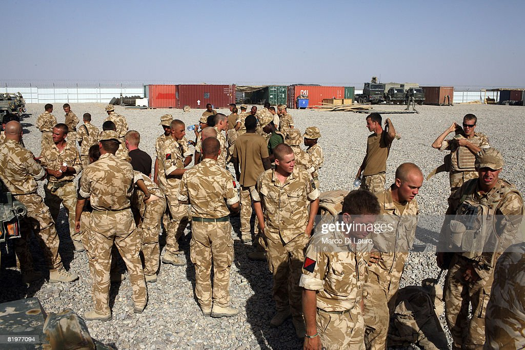 British soldiers from the 13th Air Assault Support Regiment attend a briefing by their commanders as they prepares their trucks prior to an operation...