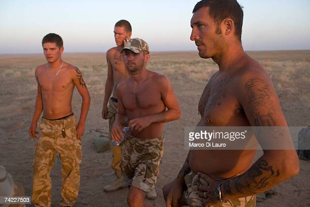 British soldiers from the B Squadron of the Light Dragoons Regiment relax as they camp in a location in the desert to conduct counterTaliban...