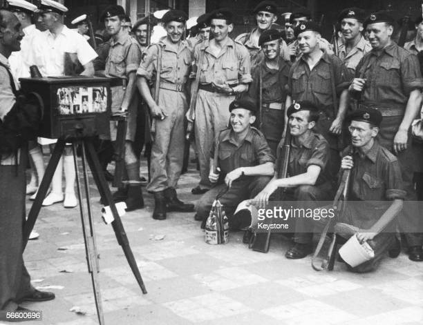 British soldiers have a group photo taken by a local street photographer in in Port Said Egypt during the Suez Crisis 27th November 1956