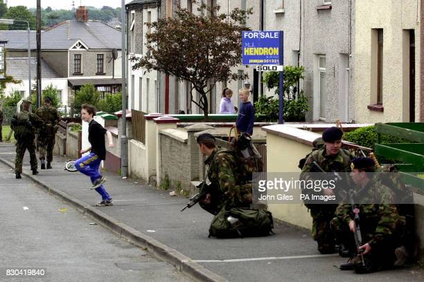 British soldiers of the Queen's Lancashire Regiment patrol the Craigwell area of Garvaghy Road as security is increased ahead of the Orange Order...