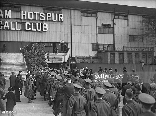 British soldiers on leave queuing outside Tottenham Hotspur's White Hart Lane ground London before a match between Arsenal and Chelsea 23rd March 1940