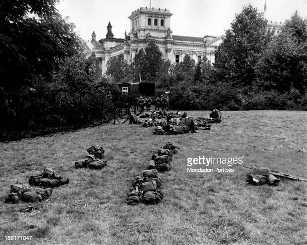 British soldiers patrolling the Brandenburg Gate area In the distance the Reichstag building East Berlin August 1961