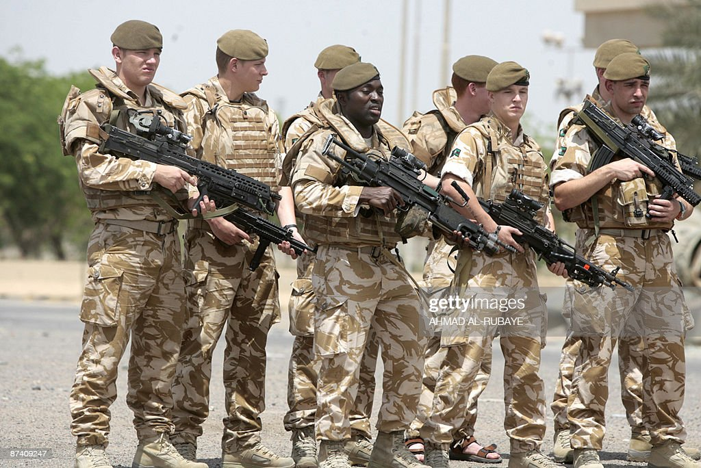 British soldiers pose for a photograph along the parade ground in Baghdad's fortified 'Green Zone' on May 16 2009 Six years following the USled...